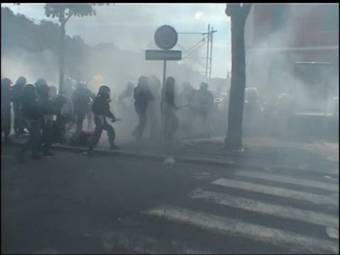 planning for g8 summit in gleneagles tx genoa gvs violent clashes between italian riot police and protestors at the genoa g8 summit gv riot police... - g8 stock-videos und b-roll-filmmaterial