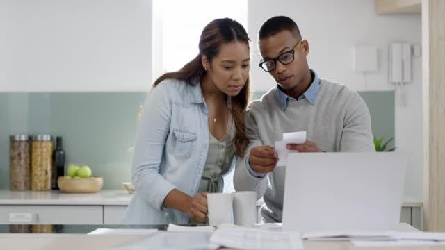 vídeos de stock e filmes b-roll de planning the home budget can be frustrating - financial bill