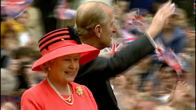 plans announced for queen's diamond jubilee celebrations; lib ext queen elizabeth ii and prince philip, duke of edinburgh waving to crowd from... - diamantenes jubiläum stock-videos und b-roll-filmmaterial