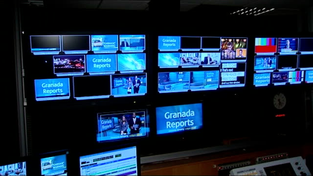 Plans for better broadband / ITV regional news pilot scheme abolished LIB View of production gallery for 'Granada Reports' news show Newscasters in...