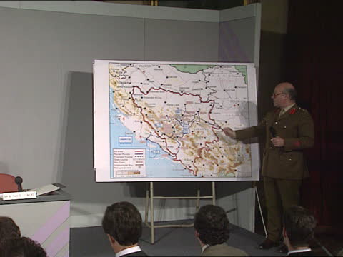 plans for british deployment revealed; c) england: london: mod: int lms mod representatives sitting at pkf army officer pointing at map - itv news at five stock videos & royalty-free footage