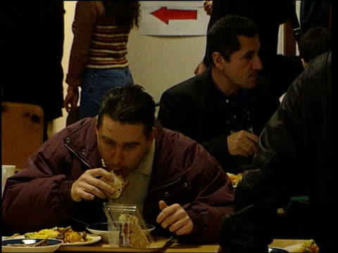 plans for new identity card itn asylum seekers queuing in canteen asylum seekers sitting eating in canteen asylum seekers playing table tennis - card table stock videos & royalty-free footage