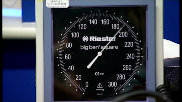 Plans for NHS sharing of GP medical records put on hold T01101335 / Stethoscope on arm as blood pressure taken Dial of 'Riester' blood pressure gauge...
