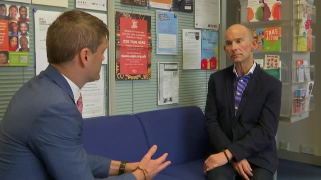 plans to axe hiv services in lambeth, lewisham and southwark; thomas lange interview sot ext reporter to camera int thomas lange in office chatting... - retrovirus video stock e b–roll