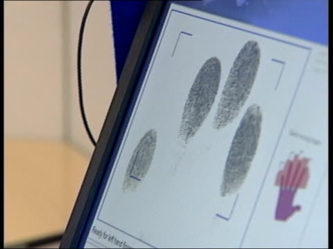 plans to introduce id cards criticised tx gvs fingerprints taken and scanned into computer clean feed tape = d0600681 or d0600680 00005606 00034815... - fingerprint stock videos & royalty-free footage