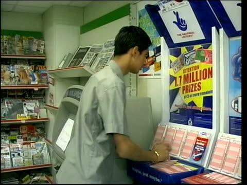 London Lottery ticket bought in newsagents shop Lottery balls in machine