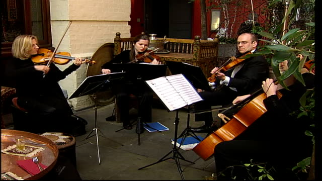 plans to regenerate west end; string quartet performing at pavement cafe - pavement点の映像素材/bロール