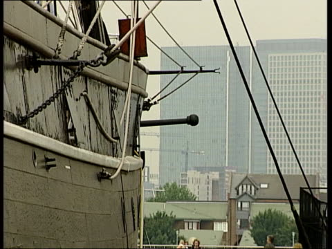 plans to save the cutty sark; england: london: greenwich: ext residential street with cutty sark seen at end of street fade to cutty sark with city... - enacting stock videos & royalty-free footage