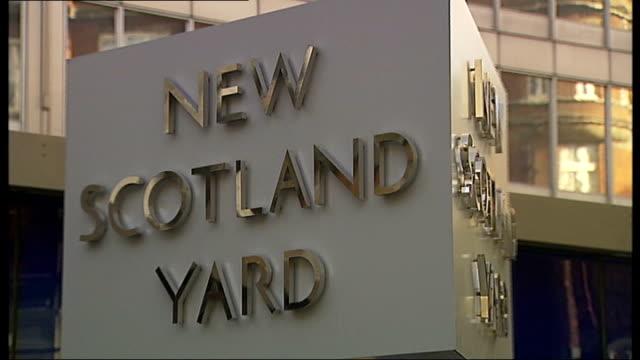 plans to sell new scotland yard building england london new scotland yard ext low angle view revolving 'new scotland yard' sign 'new scotland yard'... - ニュースコットランドヤード点の映像素材/bロール