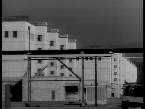 plant ms plant buildings int ms technicians at electric wall ms scientists taking out isotope from lead container tennessee atomic bomb atom bomb - 冷戦点の映像素材/bロール