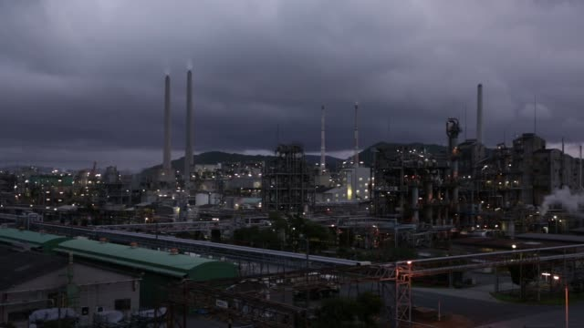 plant stands in the shunan industrial complex in shunan, yamaguchi prefecture, japan, on monday, july 20, 2015. shots: wide shot of structure in... - fade in video transition stock-videos und b-roll-filmmaterial