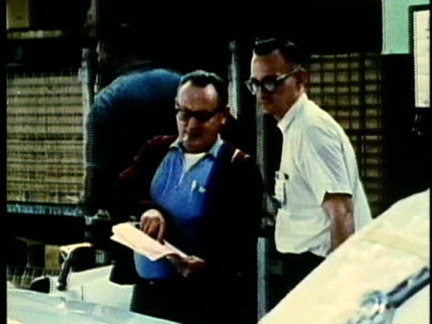 montage, plant workers, 1960's, detroit, michigan, usa - 1960 1969 stock-videos und b-roll-filmmaterial