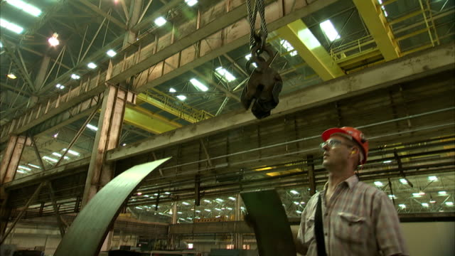 plant workers attach a crane to a rubber belt. - belt stock videos & royalty-free footage