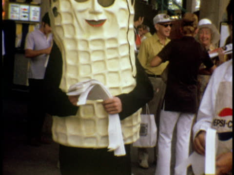 vídeos de stock e filmes b-roll de 1974 ms planter's mr peanut at the us open tennis championship at forest hills west side tennis club / queens, new york - 1974