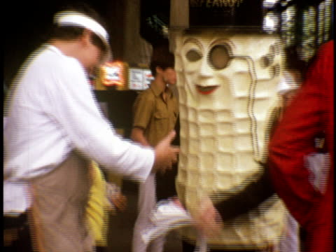 1973 ms planter's mr peanut handing out sun visors at the us open tennis championship at forest hills west side tennis club / queens, new york - 1974 stock videos and b-roll footage