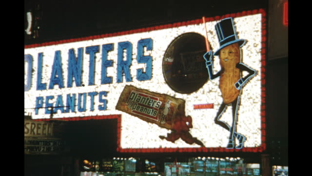 1954 ms planters peanuts sign illuminated at night, new york city, new york, united states - peanut food stock videos & royalty-free footage
