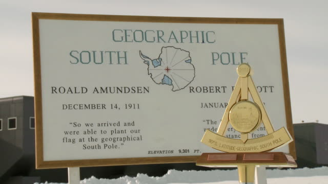cu of plaque at geographic south pole / south pole, antarctica - western script stock videos & royalty-free footage