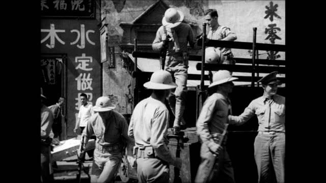 plaque 'hq marines' ws marines getting off truck ws soldier guarding entrance to power company ws soldiers marching down street chinese men watching... - united states marine corps stock-videos und b-roll-filmmaterial