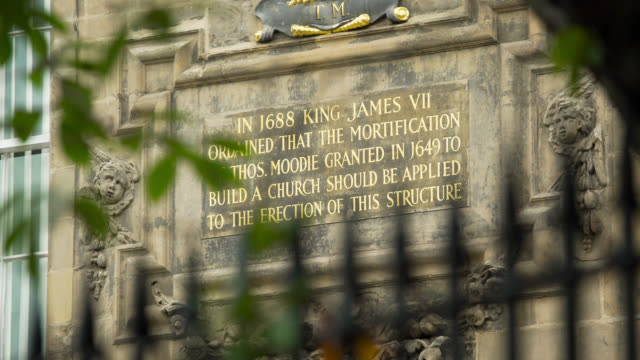 plaque on front of canongate kirk, edinburgh - capital letter stock videos & royalty-free footage
