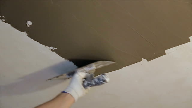 plasterer at indoor ceiling renovation decoration with float and plaster,close up - insulator stock videos & royalty-free footage