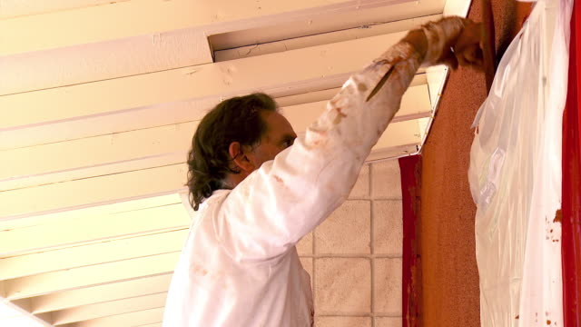 ms plasterer giving floated finishing over corners and edges along door / rancho mirage, california, usa. - rancho mirage stock videos & royalty-free footage