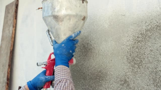 plastering works. the plaster sprays the mortar on the wall. - wall building feature stock videos & royalty-free footage