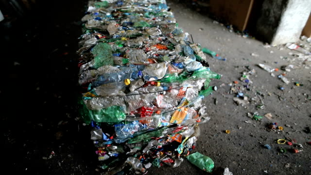 plastic bales of rubbish at the waste treatment processing plant. recycling separate and storage of garbage for further disposal, trash sorting. business for sorting and processing of waste - garbage disposal stock videos and b-roll footage