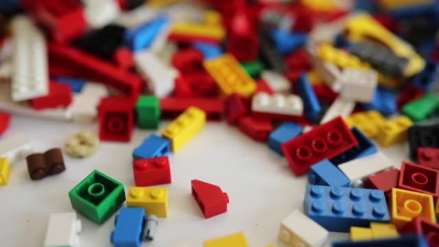 plastic blocks on table in kindergarten - cube stock videos & royalty-free footage