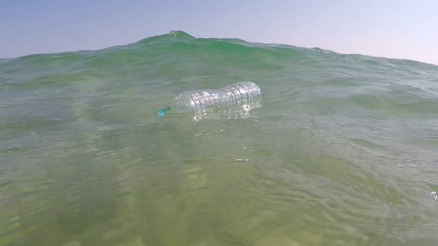 plastic bottle in the water - water bottle stock videos & royalty-free footage