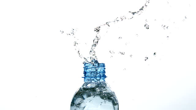 Plastic bottle spilling out water on white background