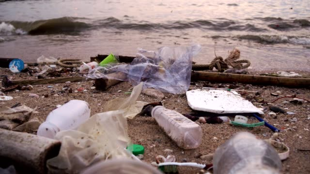 Plastic bottles and other trash on sea beach