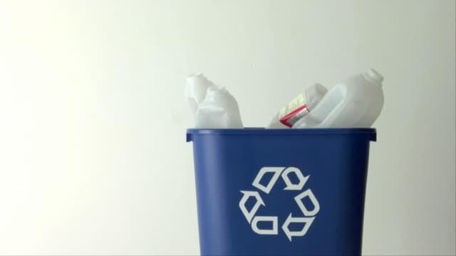 MS, Plastic bottles and wine bottle in recycling bin