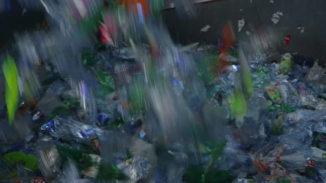 Plastic bottles being sorted at recycling plant in Norway