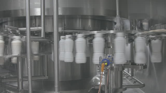 plastic bottles filling with milk. milk and milk products production line. fullhd. - cow stock videos & royalty-free footage