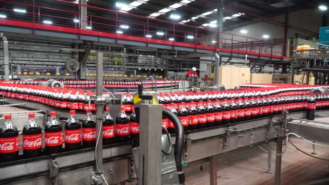 Plastic bottles of Coke soda are packaged at the end of the production line at the CocaCola Hellenic Bottling Co SA plant in Brovary Ukraine on...