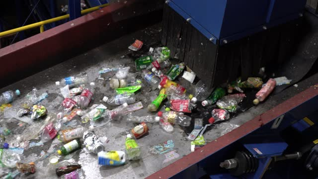 plastic bottles on a conveyor belt for recycling - automated stock videos & royalty-free footage