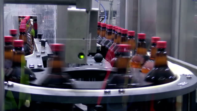 plastic bottles on conveyer belt in factory - quality control stock videos & royalty-free footage