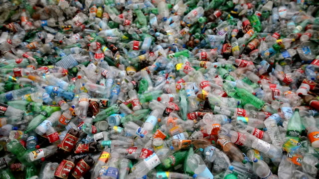 plastic bottles on the crowd.recycling factory - bottiglia video stock e b–roll