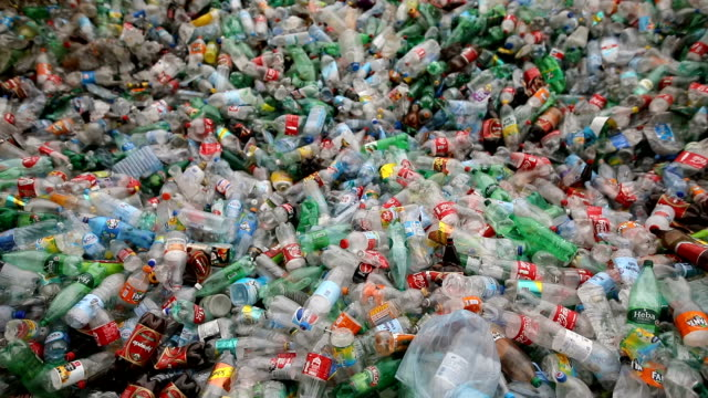 plastic bottles on the crowd.recycling factory - polyethylene stock videos and b-roll footage