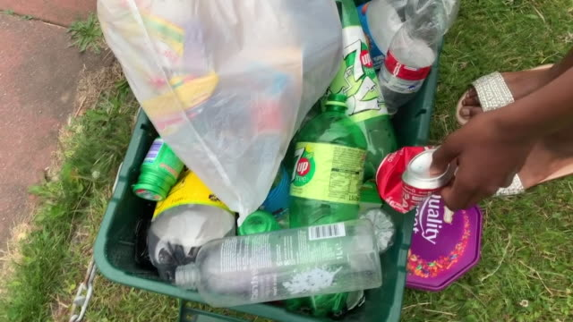plastic bottles placed into recycling bin - recycling stock videos and b-roll footage
