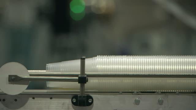 plastic cups on a production line with audio - engångsmugg bildbanksvideor och videomaterial från bakom kulisserna