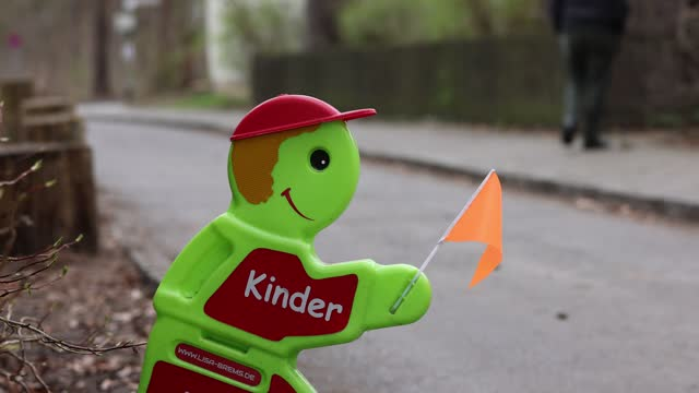 """plastic figure with the inscription """"children"""" warns motorists to drive carefully and slowly on april 03, 2021 in berlin, germany. - verkehrsschild stock-videos und b-roll-filmmaterial"""