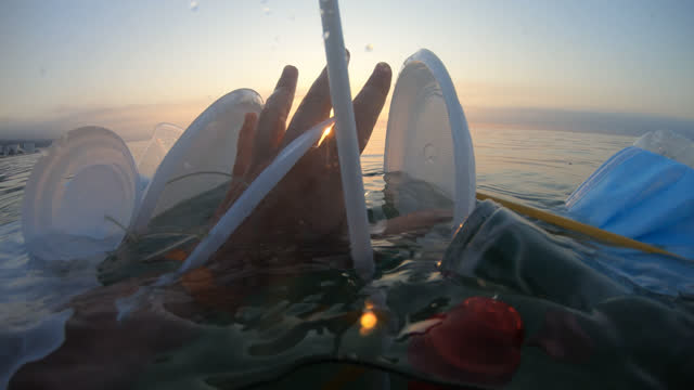 plastic garbage at sea - human limb stock videos & royalty-free footage