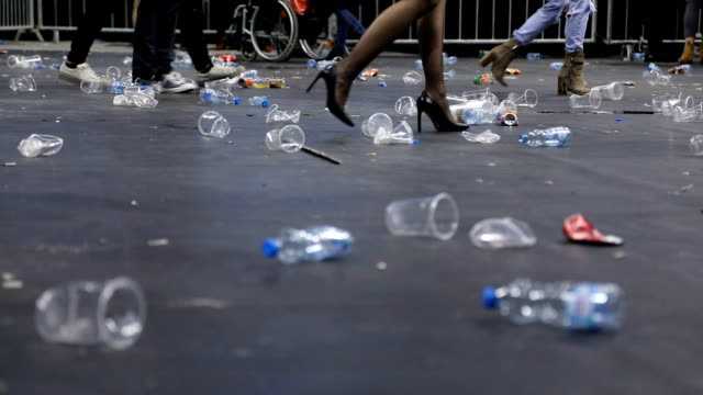 plastic glasses on the floor after the concert - disposable stock videos and b-roll footage