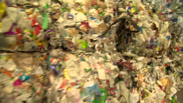 plastic in mixed bales at recyling centre waiting to be recycled - bale stock videos & royalty-free footage