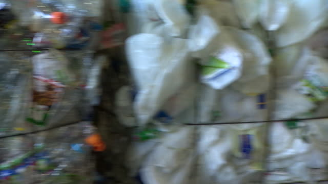 plastic in sorted bales at recycling centre - hay bail stock videos & royalty-free footage