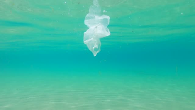 plastic in the ocean. environmental issues - 4k resolution stock videos & royalty-free footage