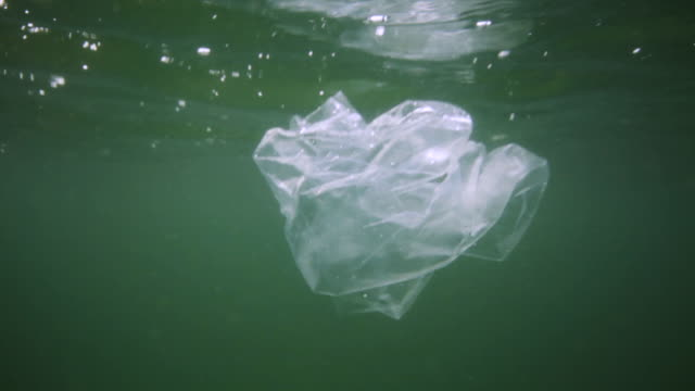 plastic in the ocean - plastic bag stock videos & royalty-free footage