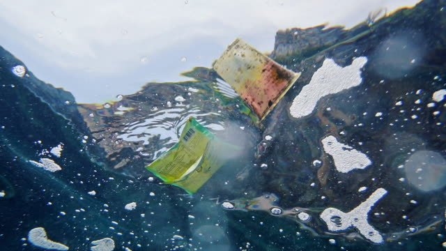 plastic pollution in the ocean underwater point of view - environmental conservation stock-videos und b-roll-filmmaterial