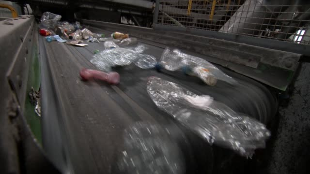 Theresa May announces proposed ban on range of plastic products R221217016 / ENGLAND London Lea Riverside INT Various of plastic bottles on conveyor...